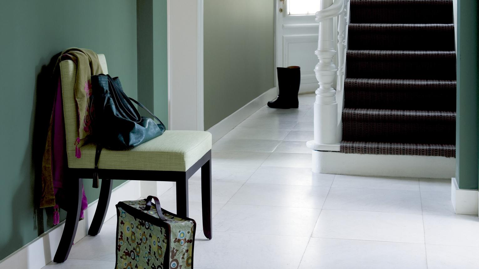 Blend shades of green for an elegant hallway