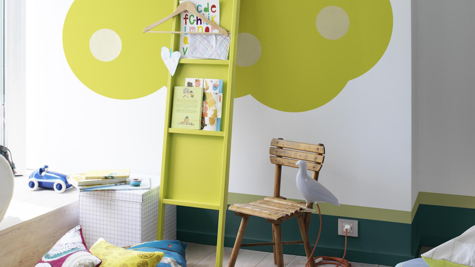 Bright green tree painted in children's room