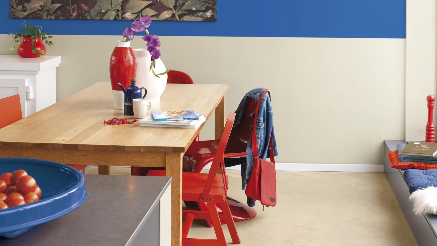 Bright paint colours create a separate kitchen dining space.