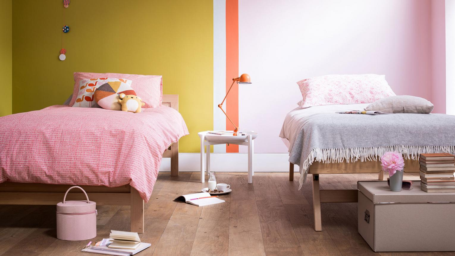 Decorating a bedroom that's shared by two little girls? Cater for different tastes in a shared space by using colour in clever ways.