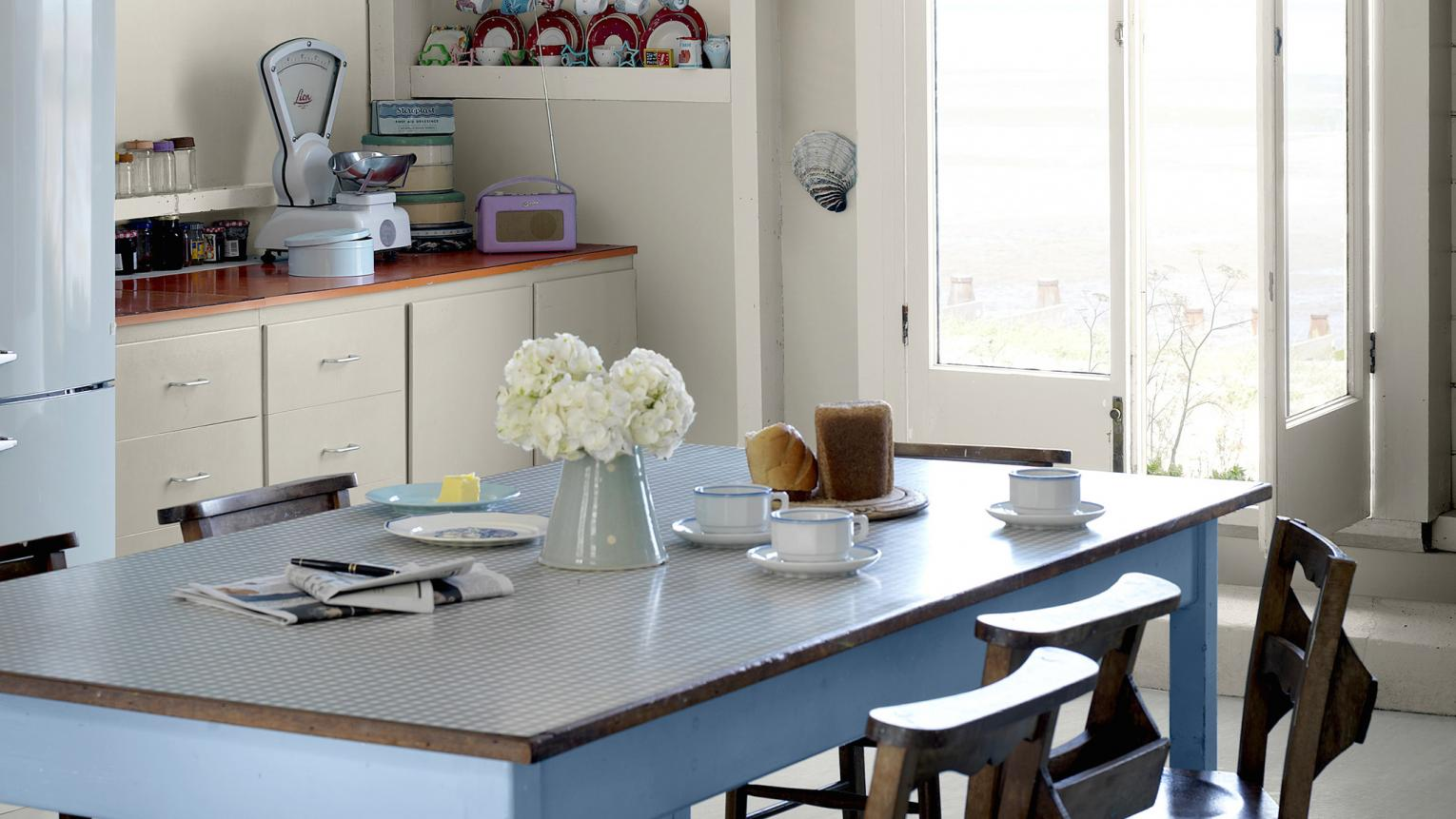 Blend warm blues and cool neutrals to create a stylish English country kitchen