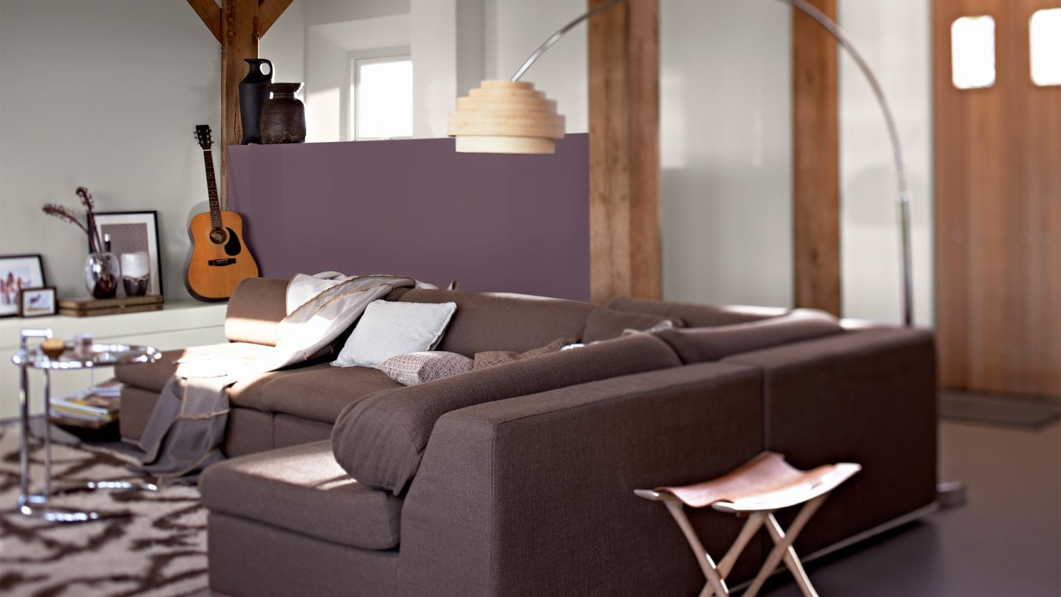 Decorating an open plan living room? Use a colour that  defines different areas in an open-plan room.