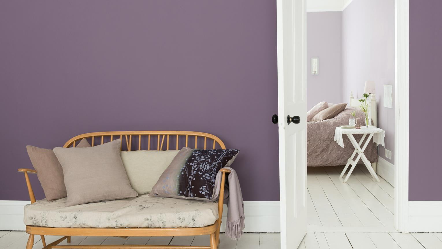 Make a bold statement in the hallway with a purple and white colour scheme.