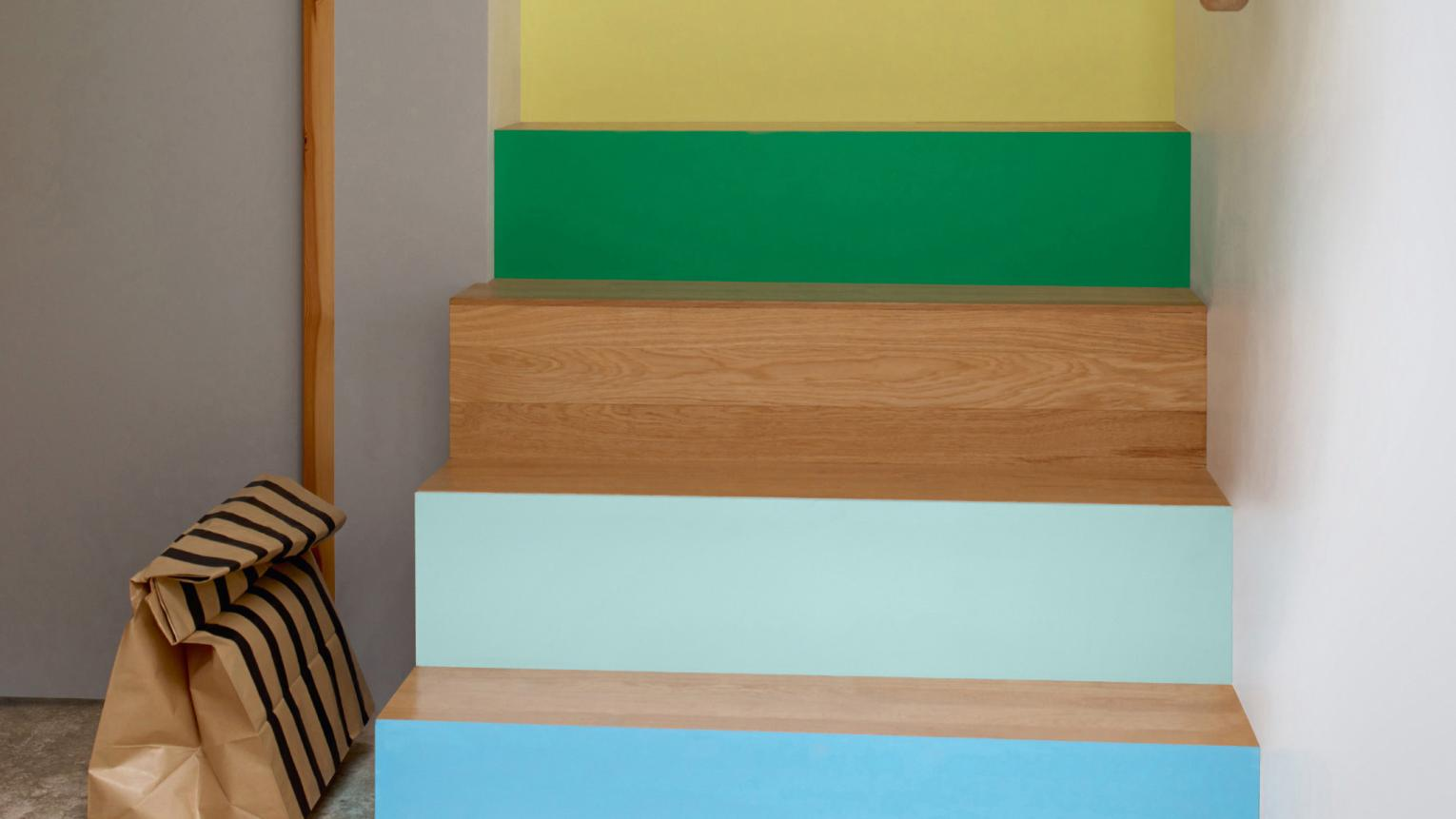 Use a multi-coloured colour scheme to create a statement staircase.