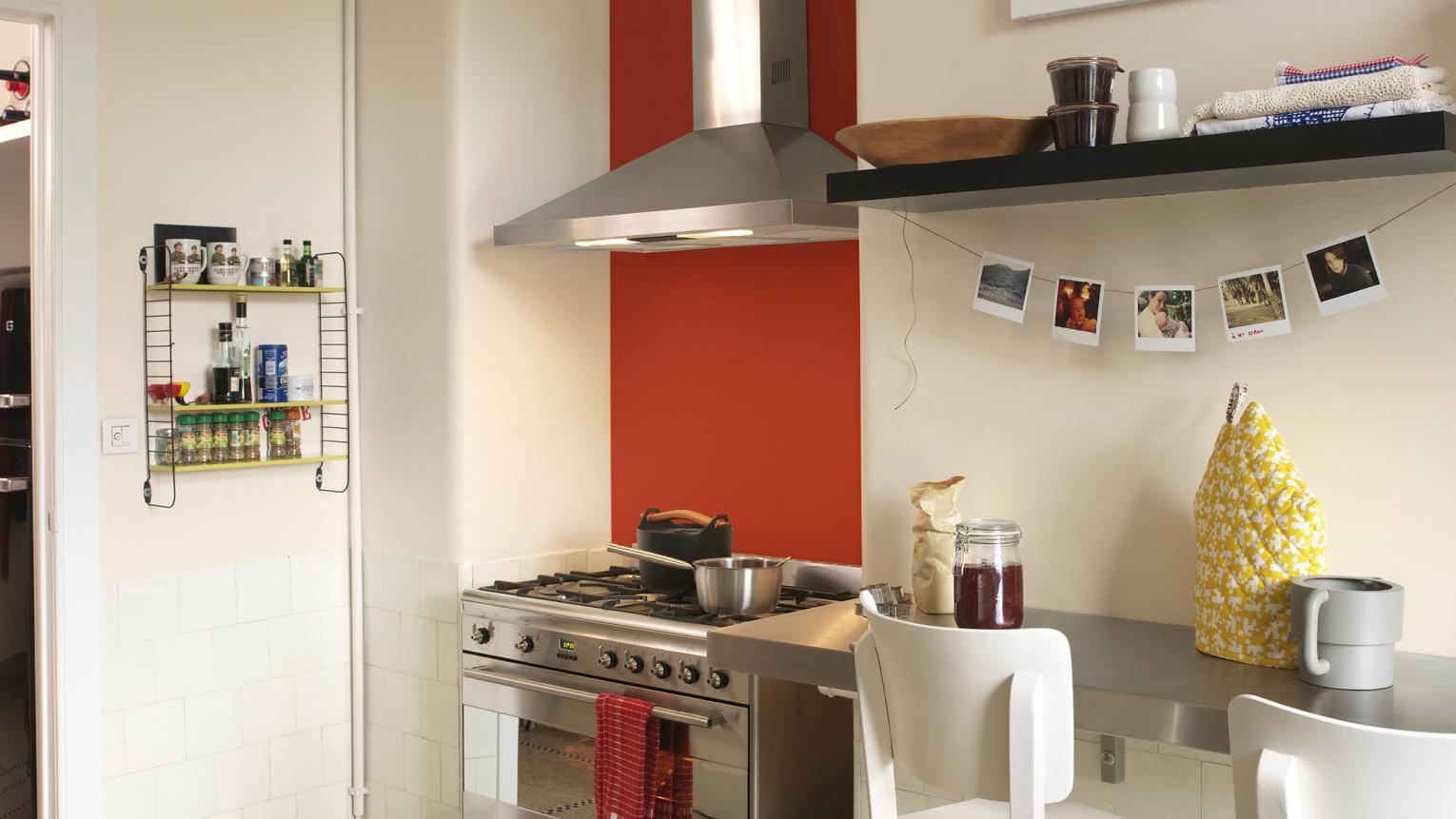 Neutral kitchen with one bright red wall
