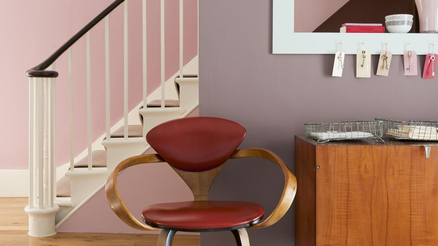 Soft pinks and purples combined with retro furniture gives a nostalgic feel to any room.