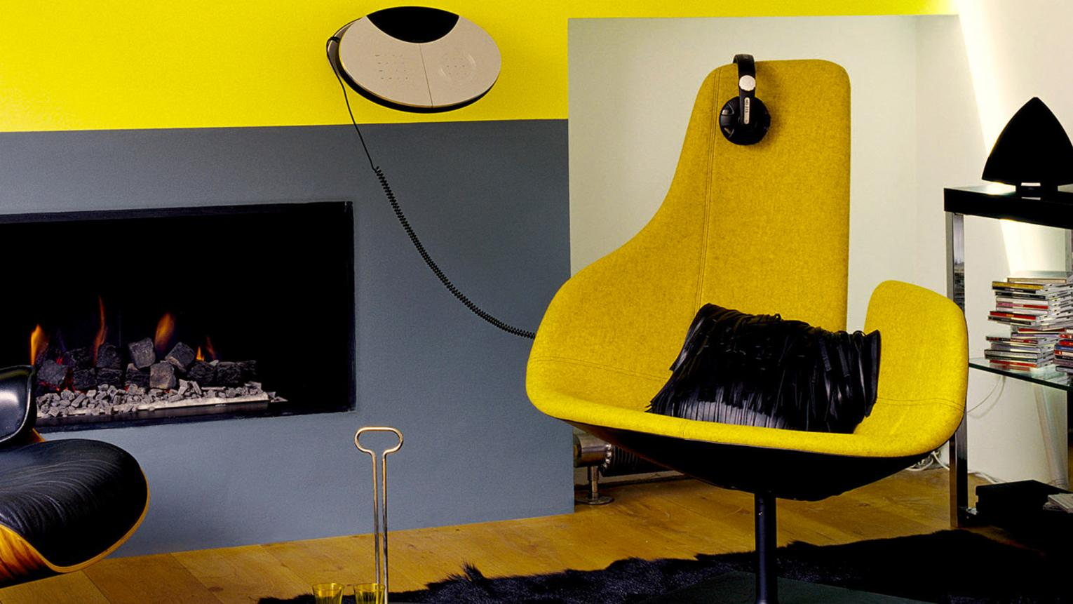 Sophisticated grey living room mixed with bright yellow pops of colour.