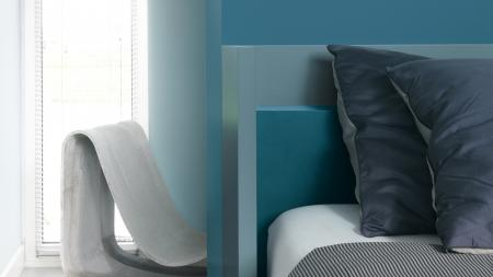 Create a restful bedroom with teal tones