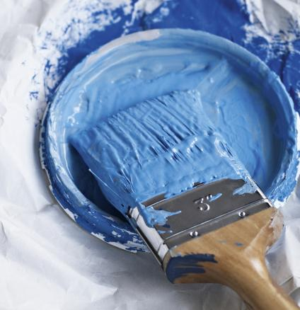 Paint brush covered in blue paint